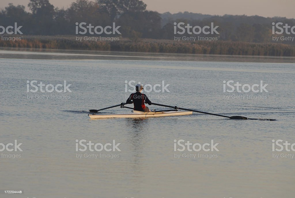 Sunrise rower stock photo