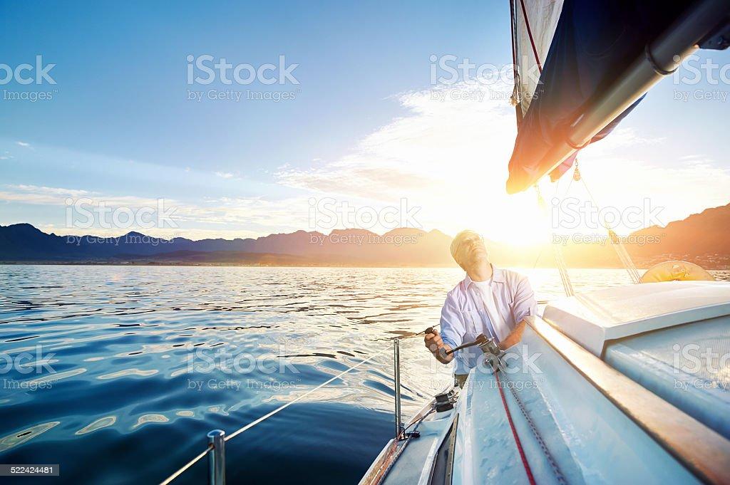 sunrise sailing boat stock photo