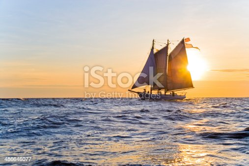 Silhouette of an Historic Tall Ship Sailing on a Calm Ocean Morning