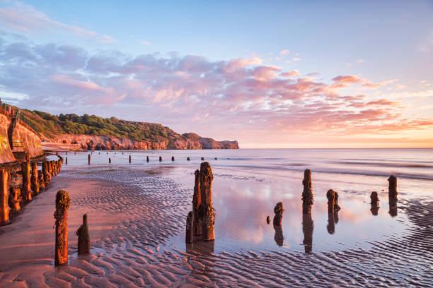 Sunrise Sandsend Beach Whitby North Yorkshire UK stock photo