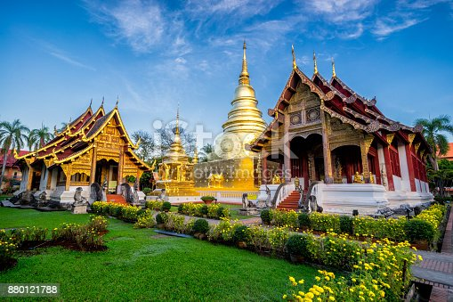 istock Sunrise scence of Wat Phra Singh temple. This temple contains supreme examples of Lanna art in the old city center of Chiang Mai,Thailand. 880121788