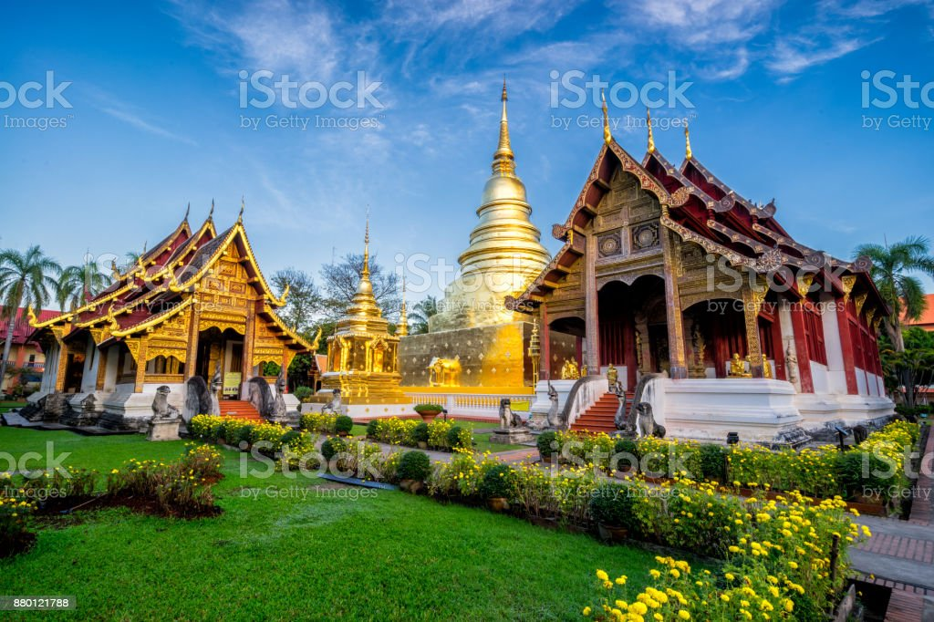 Sunrise scence of Wat Phra Singh temple. This temple contains supreme examples of Lanna art in the old city center of Chiang Mai,Thailand. stock photo