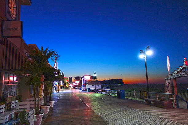Sunrise Scene, Atlantic City, NJ Sunrise Scene at Boardwalk in Atlantic City, NJ boardwalk stock pictures, royalty-free photos & images