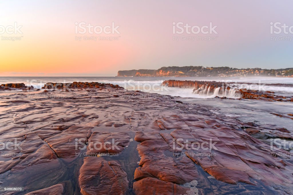Sunrise Seascape from Tessellated Rock Platform stock photo