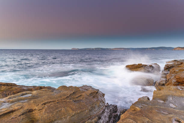 Sunrise Seascape from the Headland with Clear Skies stock photo
