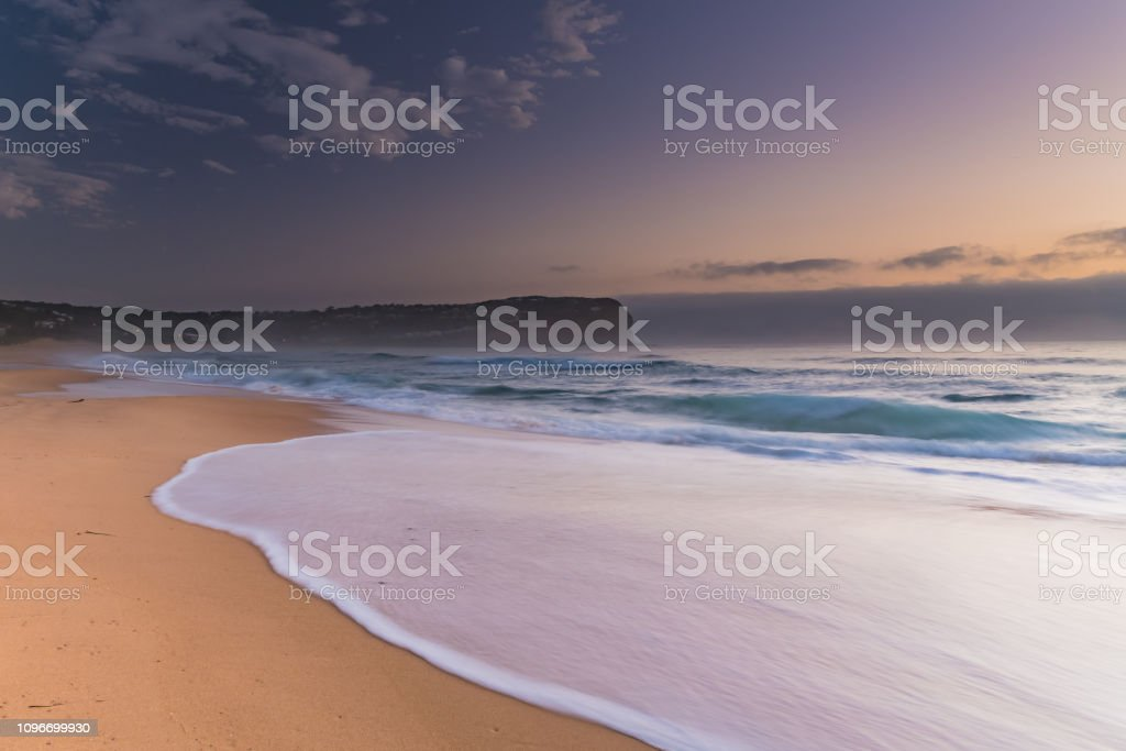Sunrise Seascape the Beach and Low Cloud Bank stock photo