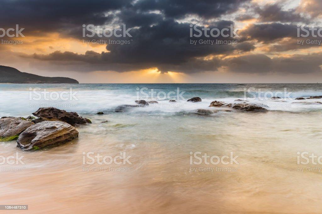 Sunrise Seascape with Sun Rays stock photo