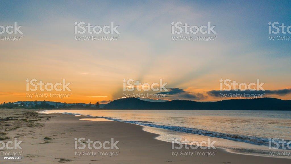 Sunrise Seascape with Sunrays stock photo