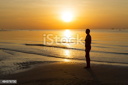 494377786istockphoto Sunrise show body silhouette 494379730
