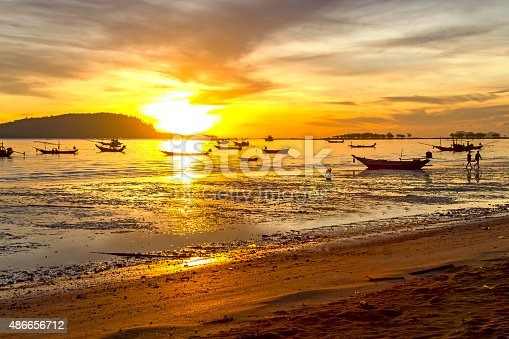 494377786istockphoto Sunrise silhouette boat 486656712