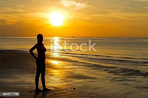 istock Sunrise silhouette lady 494377786