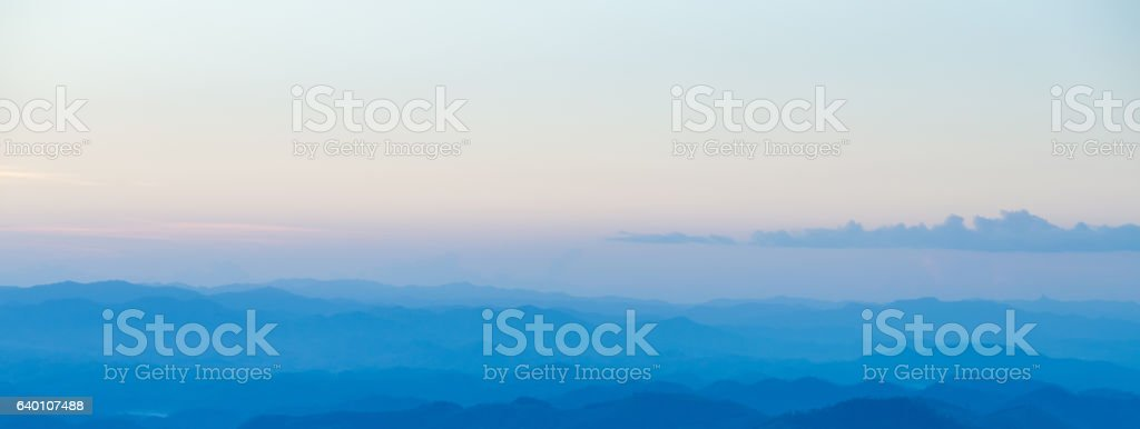 Sunrise sky and misty layer mountain in the morning stock photo
