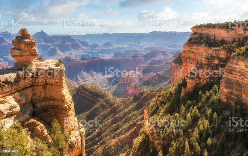 Sunrise spilling into the Grand Canyon at Desert View road pull over royalty-free stock photo