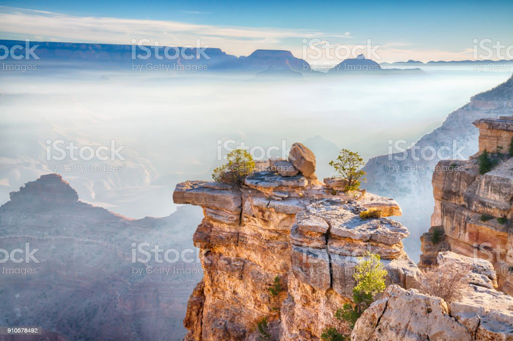 Sunrise Through the Fog in the Grand Canyon, Arizona royalty-free stock photo