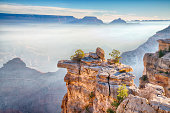 Rays of sunlight across the morning fog in  Grand Canyon, Arizona from the South Rim