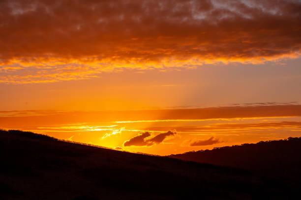 Sunrise through the mountains stock photo