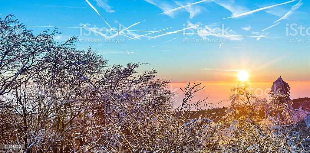sunrise under the winter calm mountain landscape with beautiful fir...