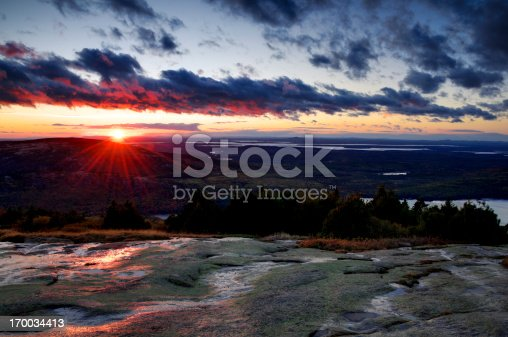 Early monring sun rays as viewed from the top of Cadillac Mountain, Acadia National Park, Maine.