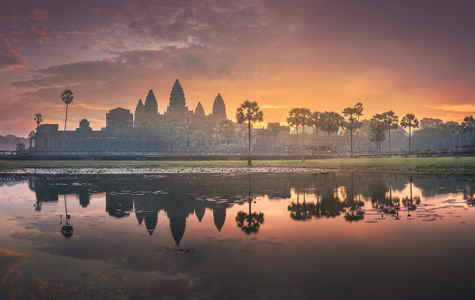 istock Sunrise view of ancient temple complex Angkor Wat Siem Reap, Cambodia 1128402987