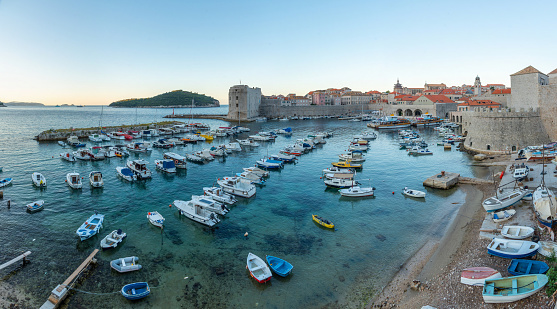 Sunrise view of boats mooring in the old port of Dubrovnik, Croatia