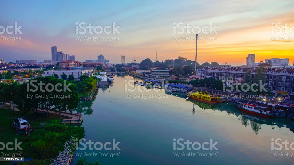 Sunrise view of Malacca city from the riverside. Noise slightly appear due to high ISO stock photo