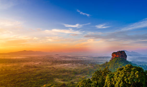 Sunrise view to Sigiriya rock - Lion Rock - from Pidurangala Rock in Sri Lanka Sunrise view to Sigiriya rock from Pidurangala rock in Sri Lanka unesco stock pictures, royalty-free photos & images