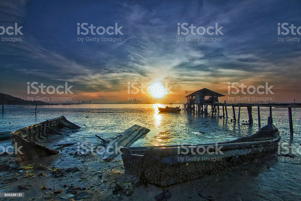 Sunrise View With Unused Boat Stuck On The Beach During Low