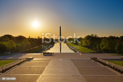 Sunrise scene of the Washington Monument viewed from the Lincoln Memorial of Washington DC, USA.