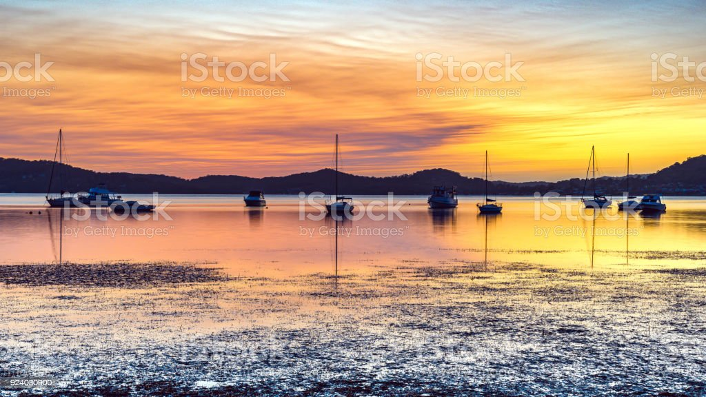 Sunrise Waterscape with Boats on the Bay stock photo
