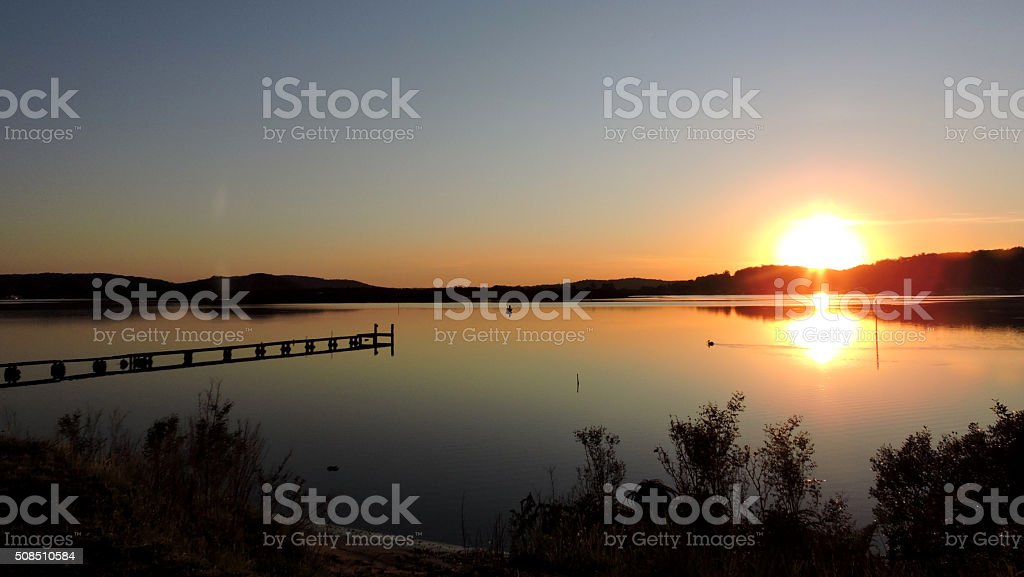 Sunrise waterscape with wharf stock photo