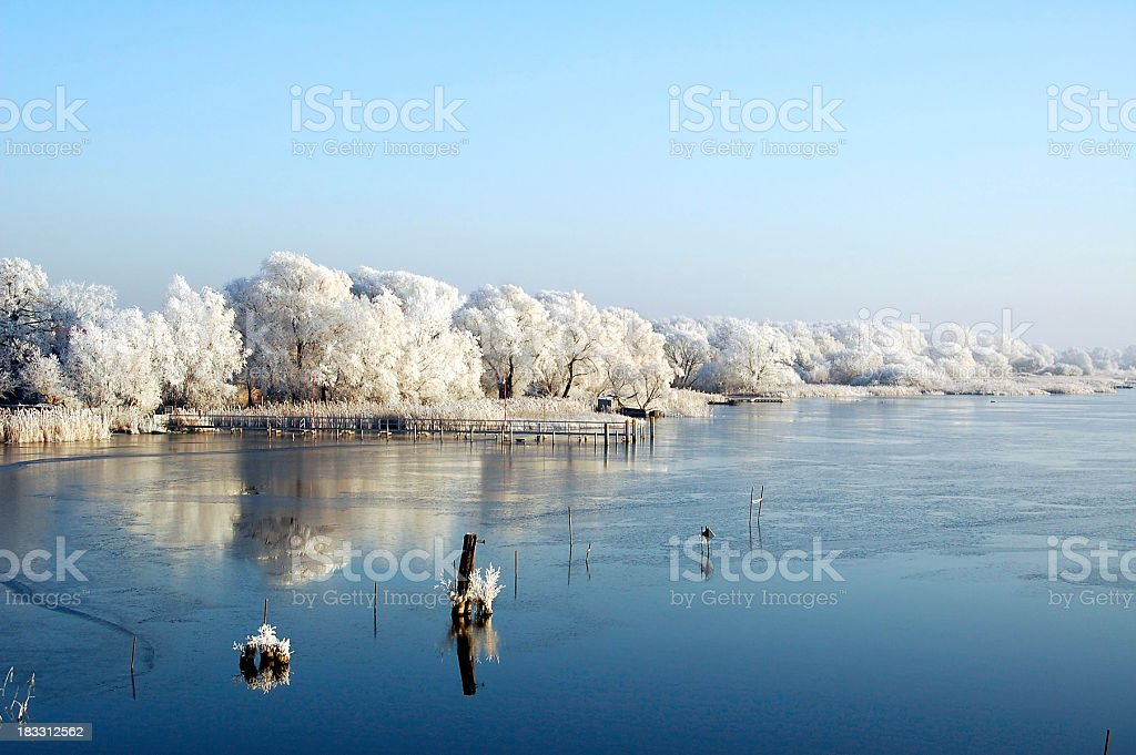 sunrise winter landscape of a lake (Brandenburg Germany) stock photo
