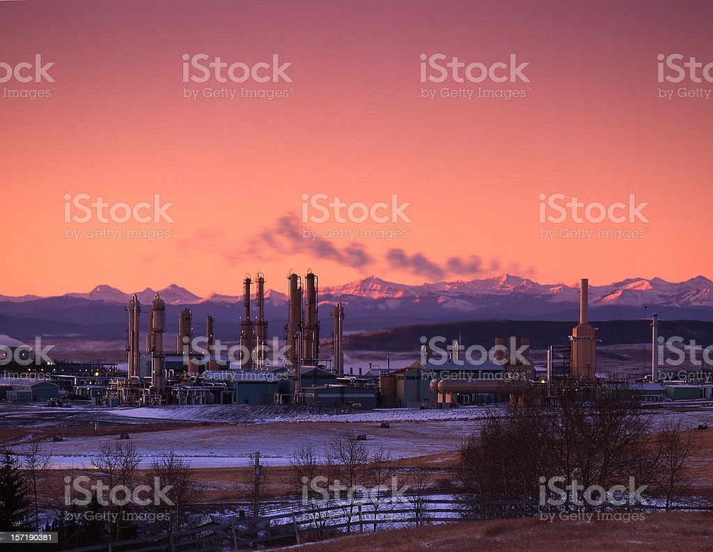 Sunrise with Gas Plant and Mountains stock photo