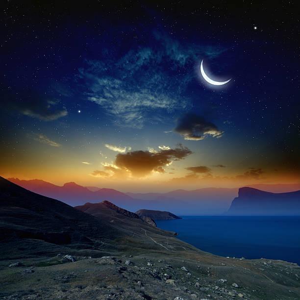 Sunrise with moon stock photo