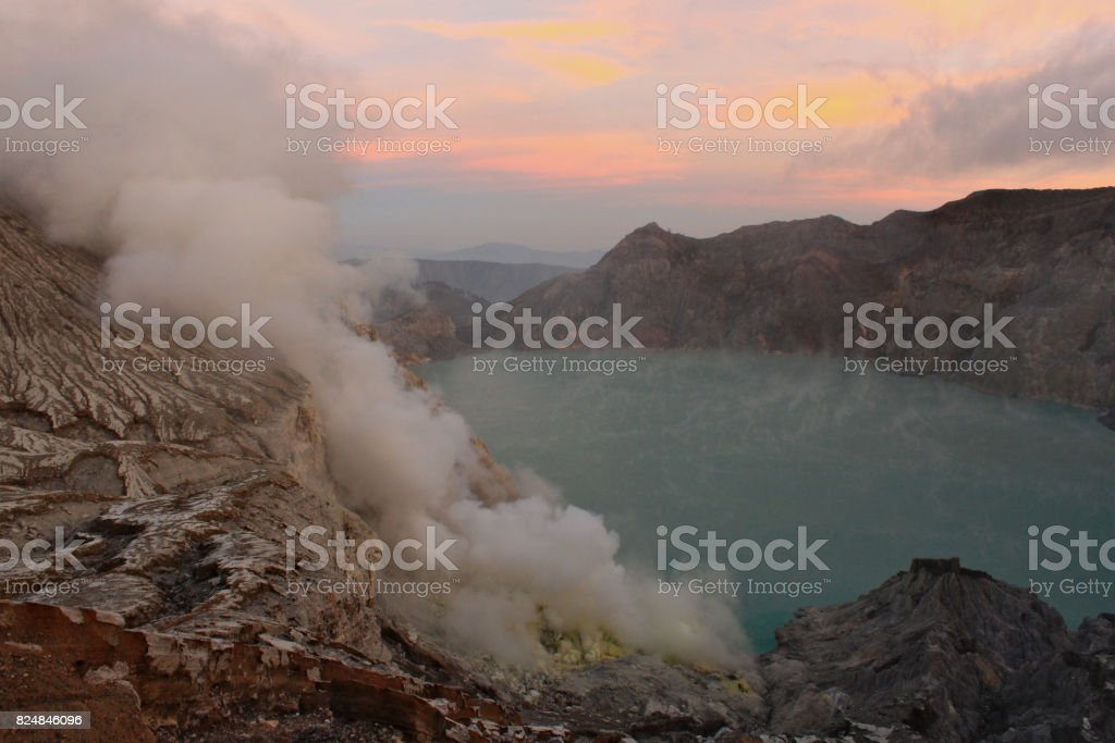 Sunrise with panoramic view on lake side next to Ijen Volcano. stock photo