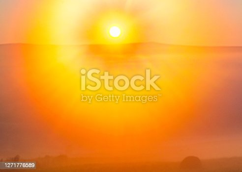 istock Sunrise with whole spectrum and round rays. 1271776589