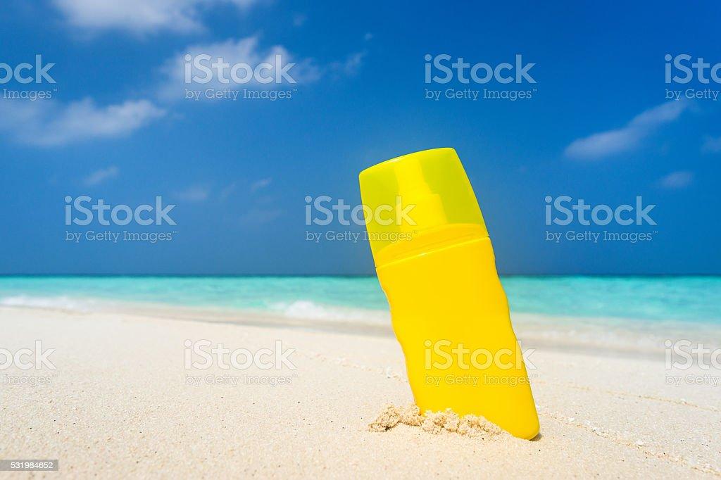 Sunscreen cream bottle on the beach stock photo