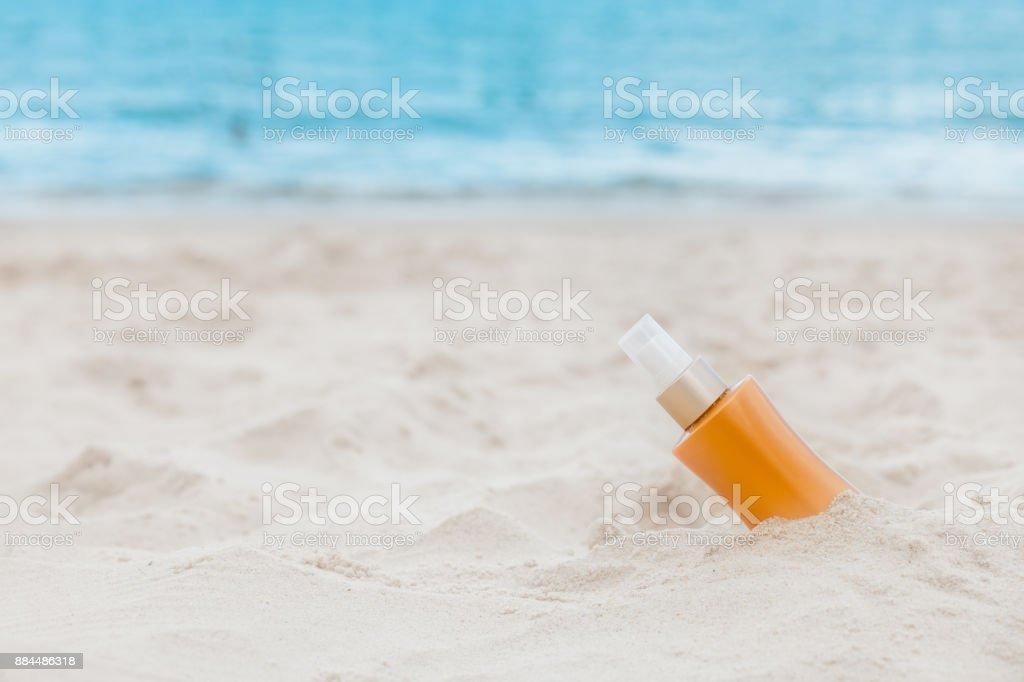 Sunscreen sunblock spf cream on the sea beach sand summer tropical holiday concept stock photo