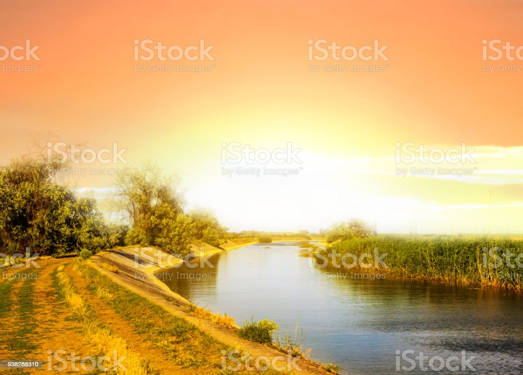 sunset above a summer river stock photo