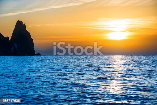 1083309578 istock photo Sunset above blue sea 586717606