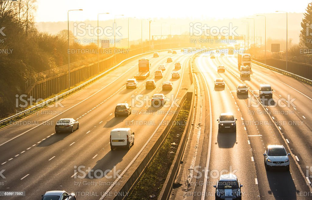 Sunset above British motorway M25 stock photo