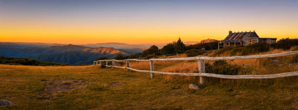 Sunset above Craigs Hut  in the Victorian Alps, Australia Sunset above Craigs Hut, built as the the set for Man from Snowy River movie in the Victorian Alps, Australia outback stock pictures, royalty-free photos & images