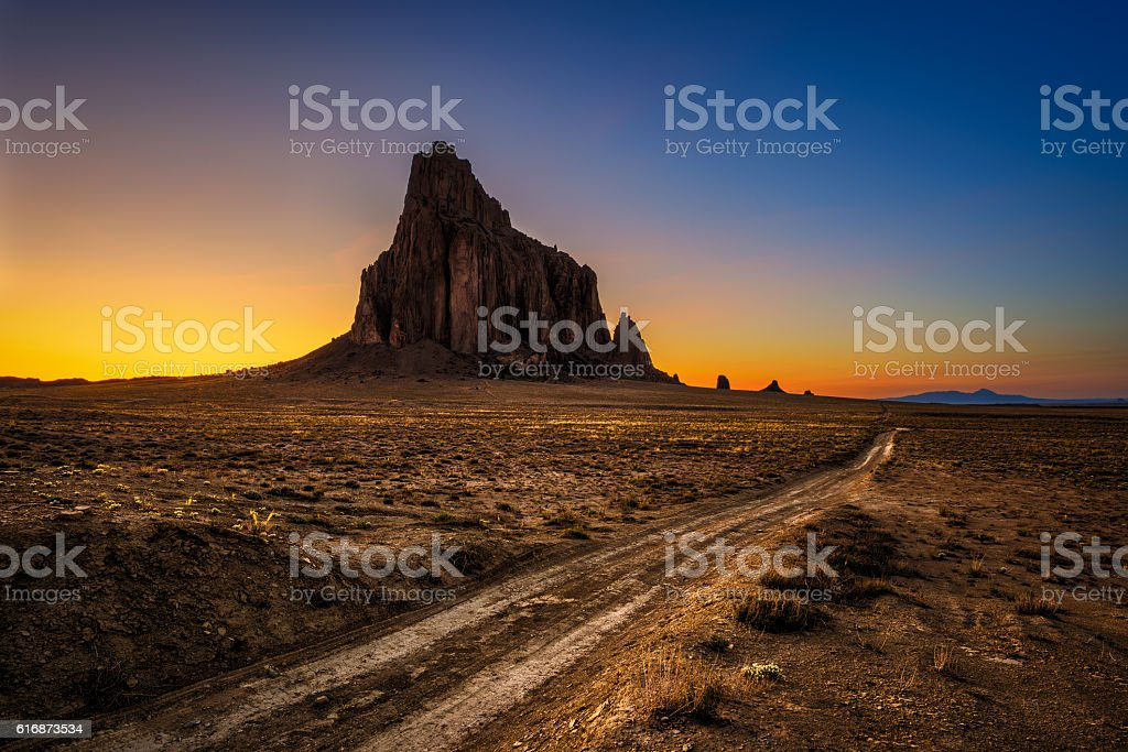 Sunset above Shiprock in New Mexico stock photo