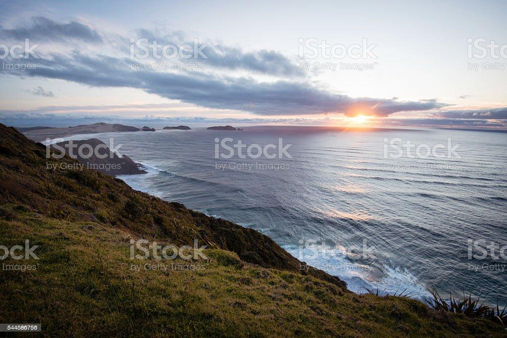 Sunset above Tasman Sea near Cape Reinga, New Zealand stock photo