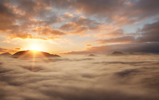 istock Sunset above the clouds 650426584