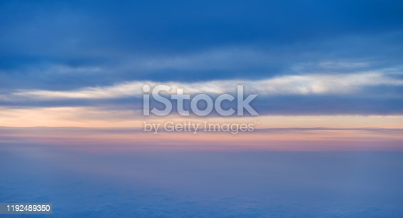184857129istockphoto Sunset above the clouds, view from airplane window 1192489350