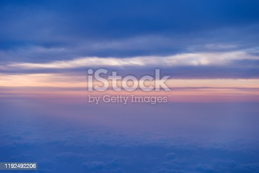 184857129istockphoto Sunset above the clouds, view from airplane window 1192492206