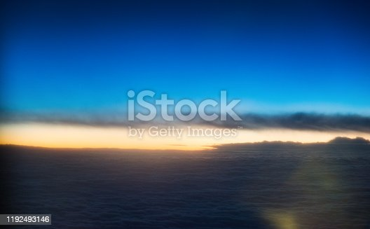 184857129istockphoto Sunset above the clouds, view from airplane window 1192493146