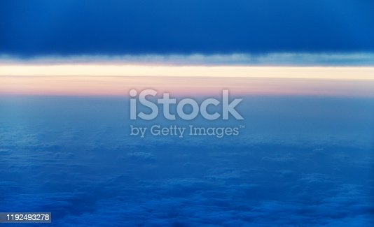 184857129istockphoto Sunset above the clouds, view from airplane window 1192493278