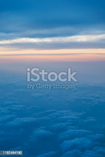 184857129istockphoto Sunset above the clouds, view from airplane window 1192494190