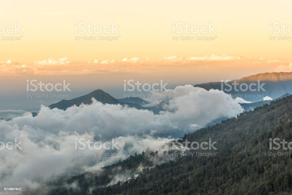 Sunset above the mountain and cloud at Mount Rinjani, Lombok Island, Indonesia. stock photo